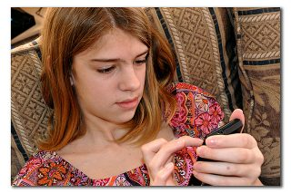 Tween using mobile phone/cell phone to text. Photo by Carlssa Rogers, https://flic.kr/p/9qQCYc