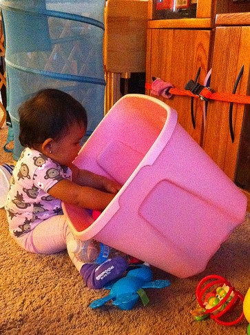 Baby explores inside of a tub
