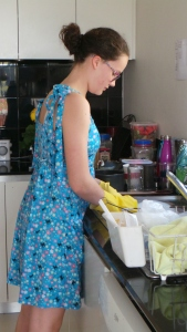 Teenage girl washes dishes